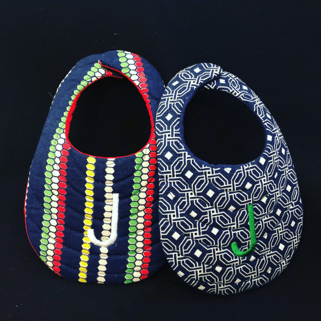 in the hoop bibs by Sue Overy Designs make a great baby shower gift