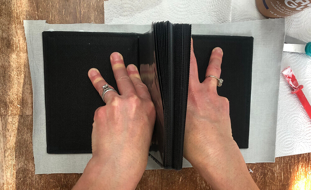 pressing album onto fabric