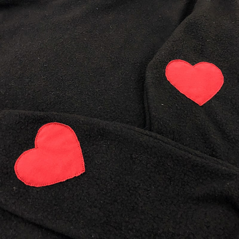 applique hearts on sleeves