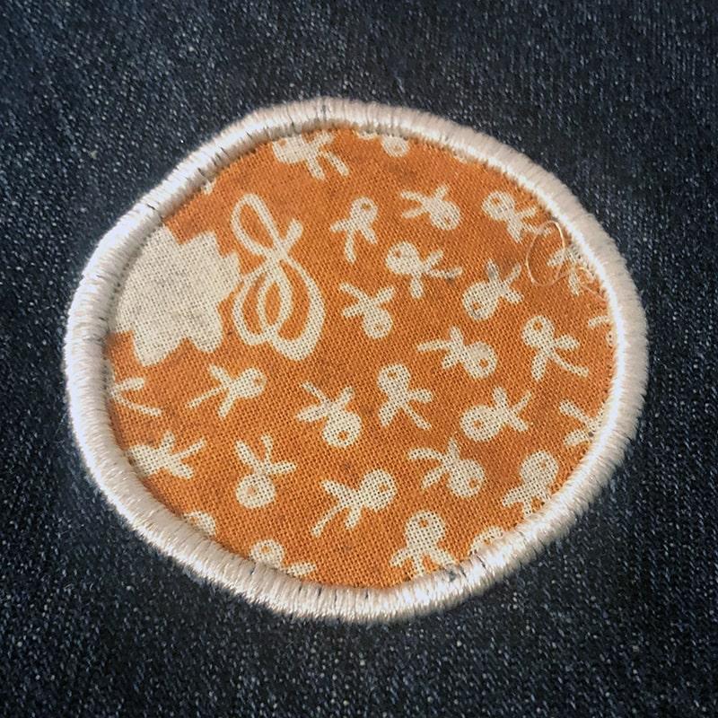 reverse applique with a satin stitch edge