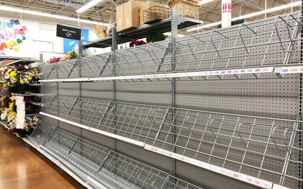 Empty fabric shelves at Walmart