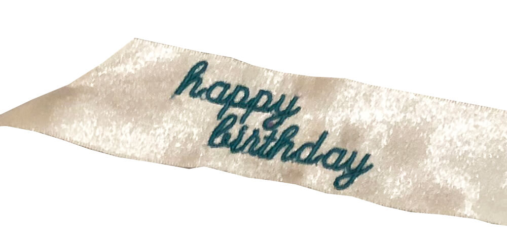 happy birthday machine embroidered on ribbon