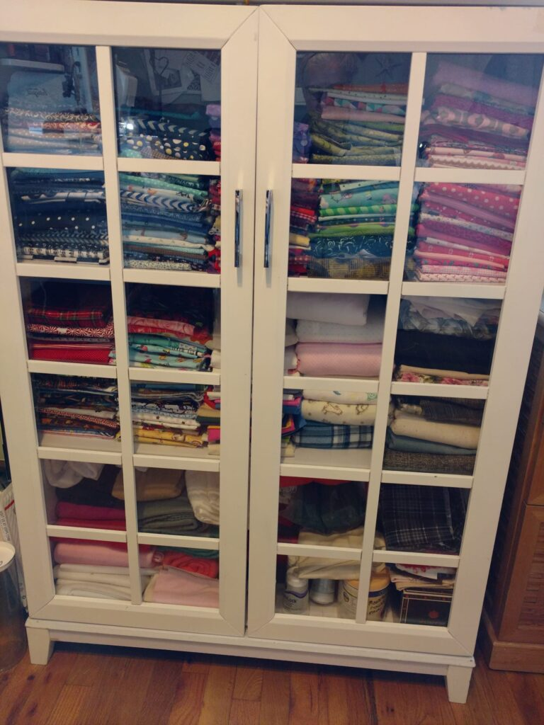cabinet with fabric neatly folded