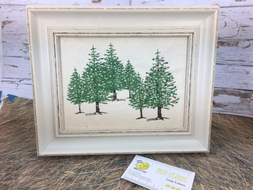 Embroidered trees in frame