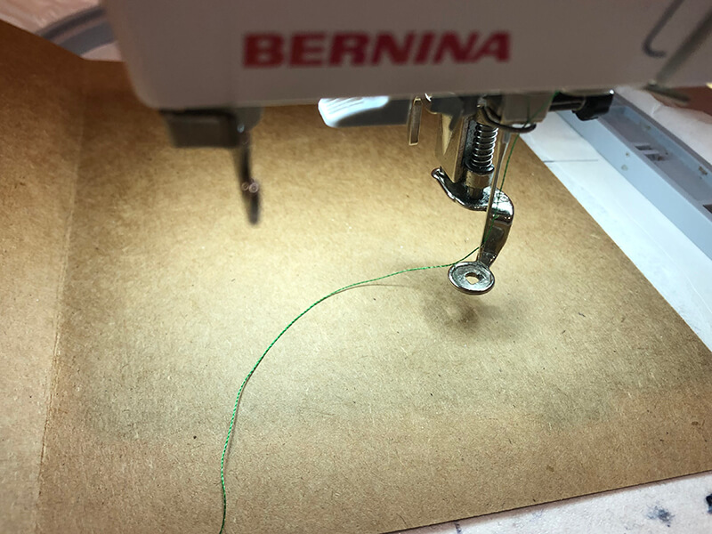 sticking the card on stabilizer is the first step to embroidering on a card