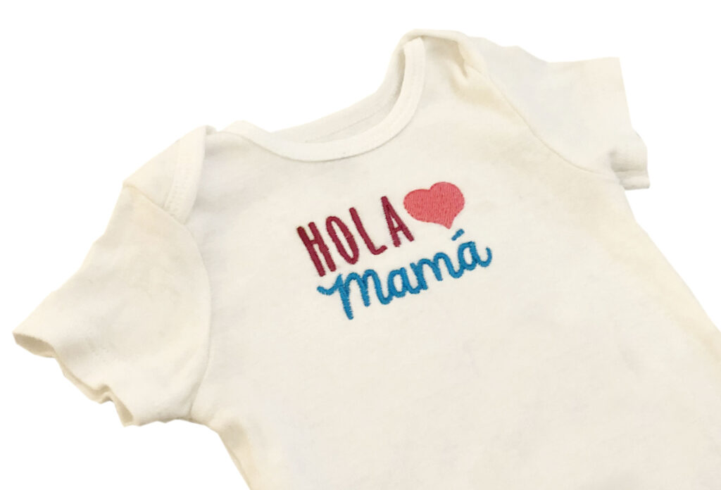 stitching an embroidery design on a onesie