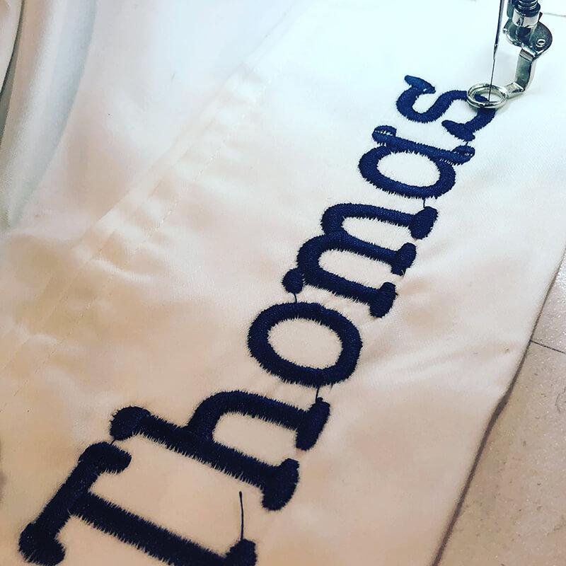 Thomas name embroidered on pillow case