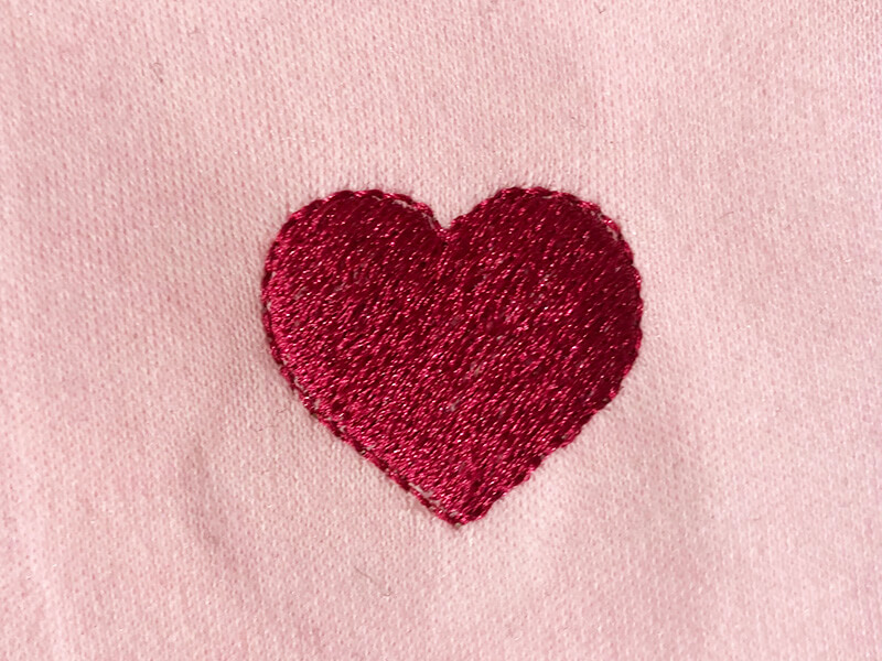finished embroidery design stitched on knit fabric
