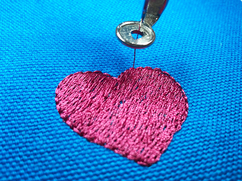 stitched out embroidery design covering the hole