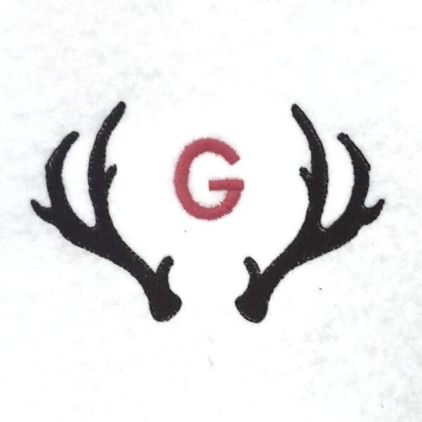 antler with single initial monogram
