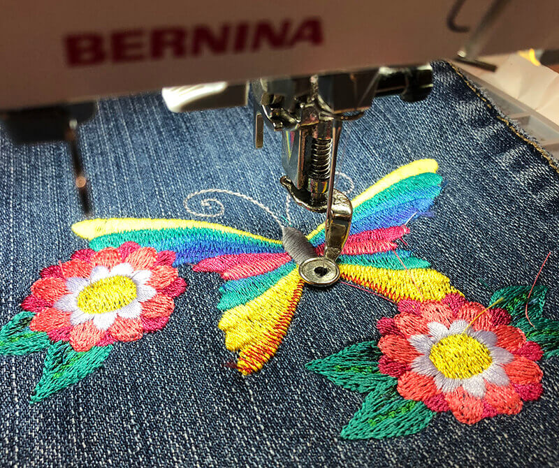 embroidering on jeans leg